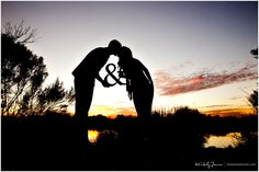 use of a wooden ampersand prop for an engagement photo -- adorable.