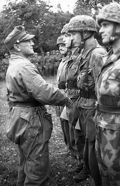 "General Eugen Meindl of II Falschirmjaeger Corps decorating troops. In contrast to many Allied commanders many senior German officers like Meindl led following the doctrine of ""Auftragstaktik"" from the front sharing the hardships and dangers of their soldiers."