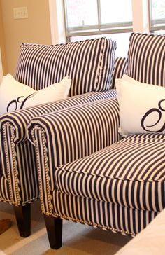 Striped chairs and monogrammed pillows :)