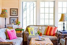 Use a generous amount of wicker to create a bohemian eclectic space like this one. Brightly patterned cushions, tablecloths and pillows on vintage woven pieces create an interesting, fun and inviting space