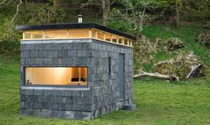 """Eight pop-up """"glamping"""" cabins built to tour the Welsh countryside Slate Cabin by Trias studio Green Architecture, Sustainable Architecture, Off Grid Cabin, Stone Facade, Tiny House Cabin, Little Houses, Tiny Houses, Cabins In The Woods, Lofts"""