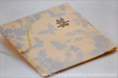 Chinese Wedding Invitation Chinese word: Double Happiness on yellow card stock and colorful butterflies images.