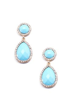 Turn your color up a notch with these baby blue stone earrings, lined with crystals on a gold backing. These earrings are approximately 2 inches in length.