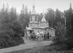 """Valamo Monastery Karelia    People and a horse carriage at a wooden Russian Orthodox church at Valamo monastery.  Lake Ladoga, Valamo, Karelia, Russia (then Finland)    Photo by Einar Erici  1930s  Riksantikvarieämbetet    """"In the past the church bell called the people to church, marked off the   special time of Sunday, noted funerals and weddings, and sounded an   alarm in case of fire or trouble.  It was also a way to talk about the  difference between the 'we' of the Lutheran church and…"""