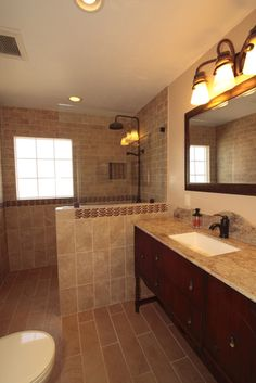 After: new walk-in shower with glass partition and porcelain tile