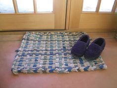 Cut up your old, torn, battered and stained T-shirts and weave them together to make this handmade rug.data-pin-do=