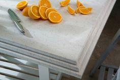 Who will ever get tired of a white kitchen? It's easy to decorate and matches any color as well. You should try this Silestone Lusso if you're planning a white kitchen. Silestone Countertops, Natural Stone Countertops, Grey Kitchens, Solid Surface, New Kitchen, Natural Stones, Orange, Fruit, It's Easy