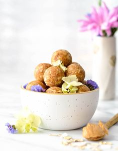 This Peanut Butter Oatmeal & Coconut Energy Bites recipe is an easy, healthy snack! It only takes 8 ingredients and 5 minutes to make! Fun lunchbox ideas too!