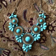 Turquoise Statement Necklace Medallion bib statement necklace in the color turquoise. Not real turquoise! Vintage Jewelry Necklaces