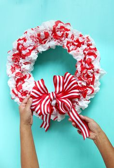 DIY Christmas Candy Cane Wreath {with Free Material! Meet our freshly made DIY Christmas candy cane wreath- isn't it lovely? Here's a quiz: can you guess what it is made of? Christmas Bags, Christmas Candy, Christmas Projects, Holiday Crafts, Christmas Wreaths, Fun Crafts, Holiday Ideas, Beautiful Christmas Decorations, Outdoor Christmas Decorations