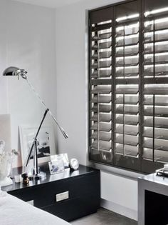 Plantation shutter shutters and dark wood on pinterest for Spanish style interior shutters