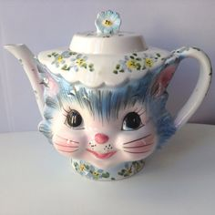 Oh my gosh! Are you kidding? This is the cutest pitcher EVER!!  For your consideration, we offer this darling vintage Lefton Miss Priss Teapot in
