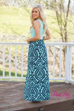 """Don't let this new maxi get away before you snag yours! It features a mint bodice with a scoopneck and 2"""" straps, an elastic waistline, and a super comfortable fabric to keep it easy to wear all summer long! The star of this dress is the beautiful damask pattern, though - the gorgeous combination of mint and navy on the skirt is so trendy!"""