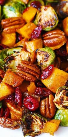 Roasted Butternut Squash and Brussels sprouts with Pecans and Cranberries is one of the best holiday side dishes youll ever try! This side dish is packed with vegetables and nuts. Its healthy gluten-free vegetarian and rich in fiber! Side Dish Recipes, Veggie Recipes, Salad Recipes, Cooking Recipes, Healthy Recipes, Cooked Vegetable Recipes, Vegetable Meals, Squash Vegetable, Cooking Food