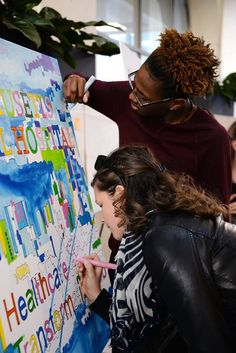 Youth artist and local professional working on an Artists For Humanity led live collaborative painting