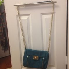 Blue cross body purse Blue purse with gold chain, zipper, and clip in the front. Multiple pockets in the bag. Make me an offer  Bags Crossbody Bags