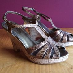 """Franco Sarto nada wedge 8 1/2M bronze Some wear on heels and back of right sole of shoe( small nicks on leather barely visible). Upper otherwise in great condition. Heels are 4 1/2"""" high. Franco sarto Shoes Wedges"""