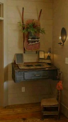 What a great idea....mount an old desk on the wall.  Maybe hubby could make me one and make it look old.