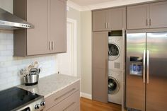 Elissa, another example of washer/dryer, next to fridge with the cabinet configuration I like.