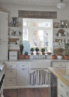 Again, loving the open shelving on both sides and the curtain under the farm house sink