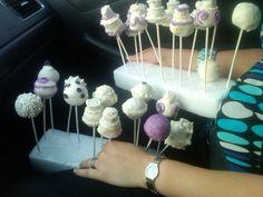 cake pops for Bridal shower. some mini wedding cakes, some regular cake pops.