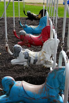 Metal horse swings. If you went too high, the steel bar would crack you on the back of the head. Photo Flickr