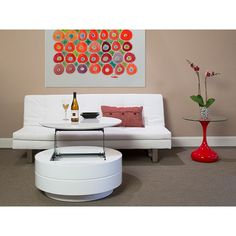 The Avery Cocktail Table will add a unique and versatile touch to any contemporary living space. Featuring a high gloss white finish, this modern cocktail table has a top that lifts and stays horizontal for various uses as a contemporary dining table or desk and provides an additional storage area. $699