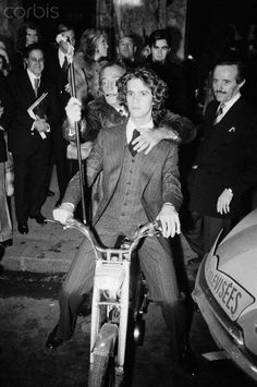 French photographer, writer and socialite Francois-Marie Banier and Spanish Catalan surrealist painter Salvador Dali attend a cocktail party at Maxim's restaurant in Paris, organized by Vogue fashion magazine. 1. november 1971