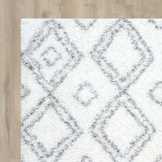 Features:  -Construction: Machine made.  -Material: 100% Polypropylene.  -Origin: Turkey.  -Pattern: Moroccan trellis.  -Baxley collection.  Primary Color: -White.  Type of Backing: -Latex.  Material: