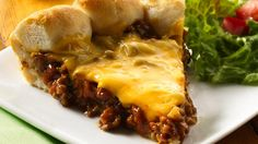 Biscuits boot the buns in a tasty cheeseburger pie!