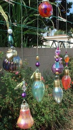 nail polish + recycled lightbulbs = fun and fabulous. I loved this idea for decorating the yard for a Christmas in July party. You could also use glass paint for these which would be cheaper and faster than the nail polish. Too much fun!
