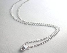 This is a long medium-weight sterling silver chain, curb chain style, although the links are slightly oval. The necklace ends in a Mens Chain Necklace, Mens Silver Necklace, Engraved Necklace, Sterling Silver Bracelets, Silver Jewelry, Nameplate Necklace, Chain Necklaces, Jewelry Art, Diamond Jewelry