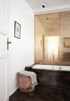 copper mirror wall in a bathroom by Norm Architects in Copenhagen Bad Inspiration, Bathroom Inspiration, Interior Design Inspiration, Furniture Inspiration, Interior Ideas, Bathroom Interior, Bathroom Wall, Copper Bathroom, Bathroom Ideas