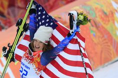 Description of . US skier Julia Mancuso poses on the podium after the Women's Alpine Skiing Super Combined Flower Ceremony at the Rosa Khuto...