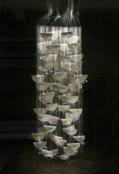Margaret O'Rorke lives and works in Oxford, England.   Large-scale translucent porcelain-lit wall sculptures and a lit fountain, showcase O'Rorke's explorations with light through wheel-thrown forms and multiples