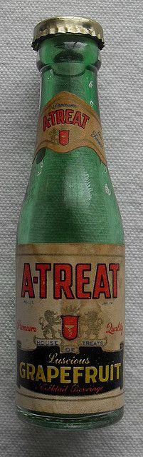 1950s A TREAT Grapefruit Soda Bottle. --In 1918 A-Treat was started three generations ago in a three-car garage in downtown Allentown (PA) by Joseph and Jack Egizio. The business moved to its present location in east Allentown in 1932 where it has produced delicious A-Treat sodas for near and distant customers for the past 75 years.