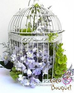 Bird cage flower arrangement with hydrangeas
