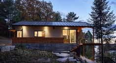 Perched on a steeply sloped site and facing west, this cottage was designed to enhance the magnificent view of the water and take advantage of the spectacular sunsets. The main level houses living, dining, kitchen, guest room and powder room with transparent walls that extend into the landscape. A covered deck with exposed douglas fir …