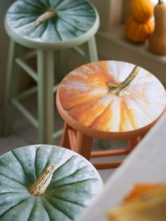 Fall Stools in Autumn Designs  Your digital camera is your ultimate DIY tool to create these colorful stools. Take a photo from overhead of pumpkins; enlarge and crop to fit a stool top and print. Choose paint in the same color as the image; paint the stool and dry. Adhere the digital image with decoupage and seal with clear polyurethane.