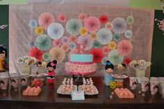 Japan themed kokeshi doll party! The paper pinwheels in the back look very cute!