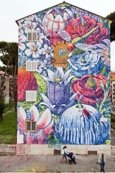 Sanba, il quartiere diventa galleria d'arte a cielo aperto con i graffiti di Hitnes