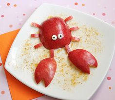 ADORABLE!!  How cute for a 'clam bake', 'crawfish boil' or 'sea inspired' party theme.  I MUST DO THIS !!!   Cute Crabby Apple snack with graham-cracker sand (try adding cinnamon to the sand!)