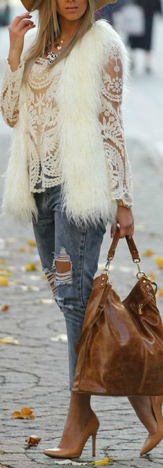 Transforming lace blouse top to Fall season by teaming it with jeans and faux fur vest