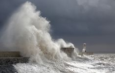 Little white lighthouse in storm