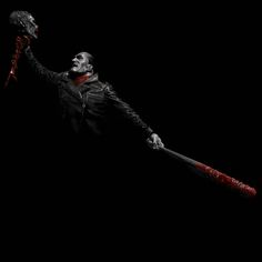 """Quick digital painting exercise of Negan from """"The Walking Dead"""".  With this piece I did no sketch or prep work at all I just created a black background, painted the highlights, and used a gradient map for the blood. I think it went well, definitely more in the future!    P.s. This is a painting I created of a sculpture, I did not create the composition on my own."""