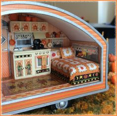 Imagine driving down a country road in the Fall and stumbling upon a little vintage trailer with a darling pumpkin-inspired interior, surrounded by a cute pumpk