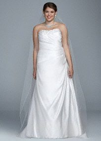 Surrender to glamour and charm in this lovely A-line satingown!  Strapless ruchedbodice with ultra-feminine sweetheart neckline is adorned with dazzling beads that is sure to catch the light. Sweep train. Sizes 14W-26W. Available online in White. Fully lined. Back zip. Imported. Dry clean only. To preserve your wedding dreams, try our Wedding Gown Preservation Kit.