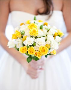 A charming bouquet of yellow and white spray roses with a few billy balls (craspedia) mixed in. Spray roses and craspedia are affordable flowers which are available year-round at GrowersBox.com.