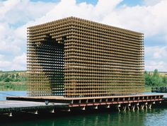 Tea Pavilion by Architectural Studio XYZ, Moscow, Russia. This project is for a tea arbour that floats on a pontoon on a lake in a sports complex. Measuring 7.6m long, 4.4m wide and 4.6m high, the structural matrix comprises almost 12,000 wooden blocks, threaded onto a 184 x 184mm grid of steel reinforcement bars to form a rigid structure.