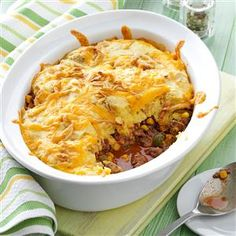 Corn Bread Taco Bake Recipe -The corn bread and beef bake together in one casserole dish, making this entree convenient. It's packed with tempting seasonings, and the cheese and onions make an attractive topping. —Vicki Good, Oscoda, Michigan